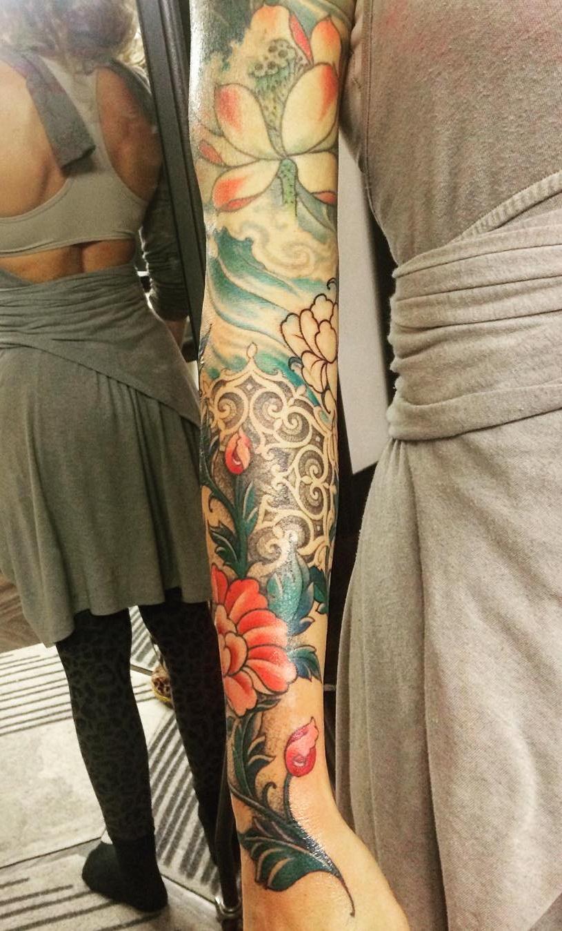 Tatuagens-femininas-de-braço-fechado-1