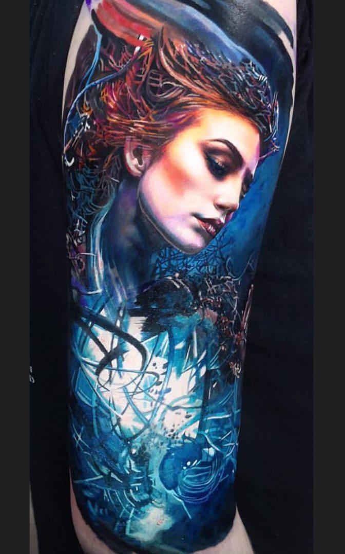 Tatuagens-na-parte-superior-do-braço-feminino-14