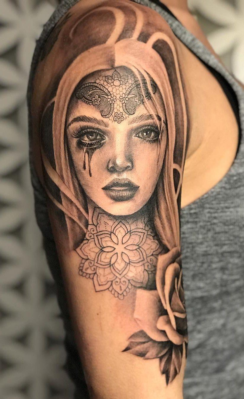 Tatuagens-na-parte-superior-do-braço-feminino-19