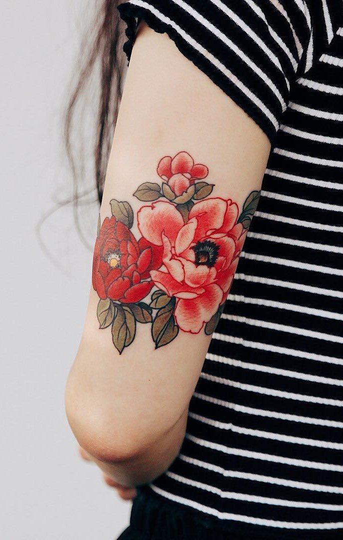 Tatuagens-na-parte-superior-do-braço-feminino-21