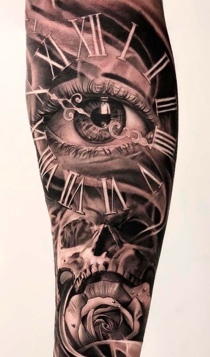 tatuagem-de-relogio-e-olho-e-caveira-no-antebraco