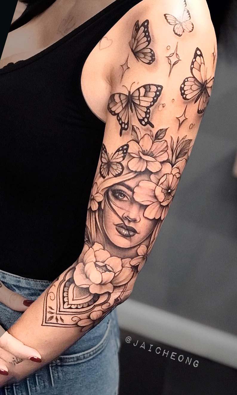 tatuagem-de-rosto-de-mulher-e-borboletas-2