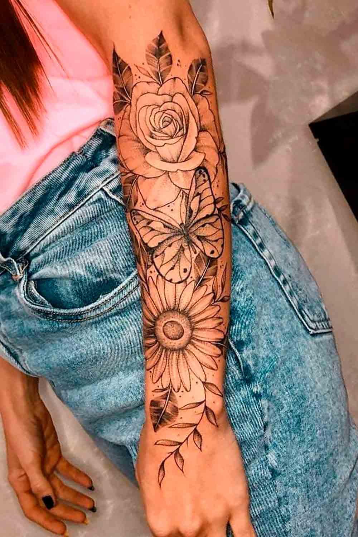 tatuagem-feminina-no-antebraco-de-girassol-borboleta-e-rosa