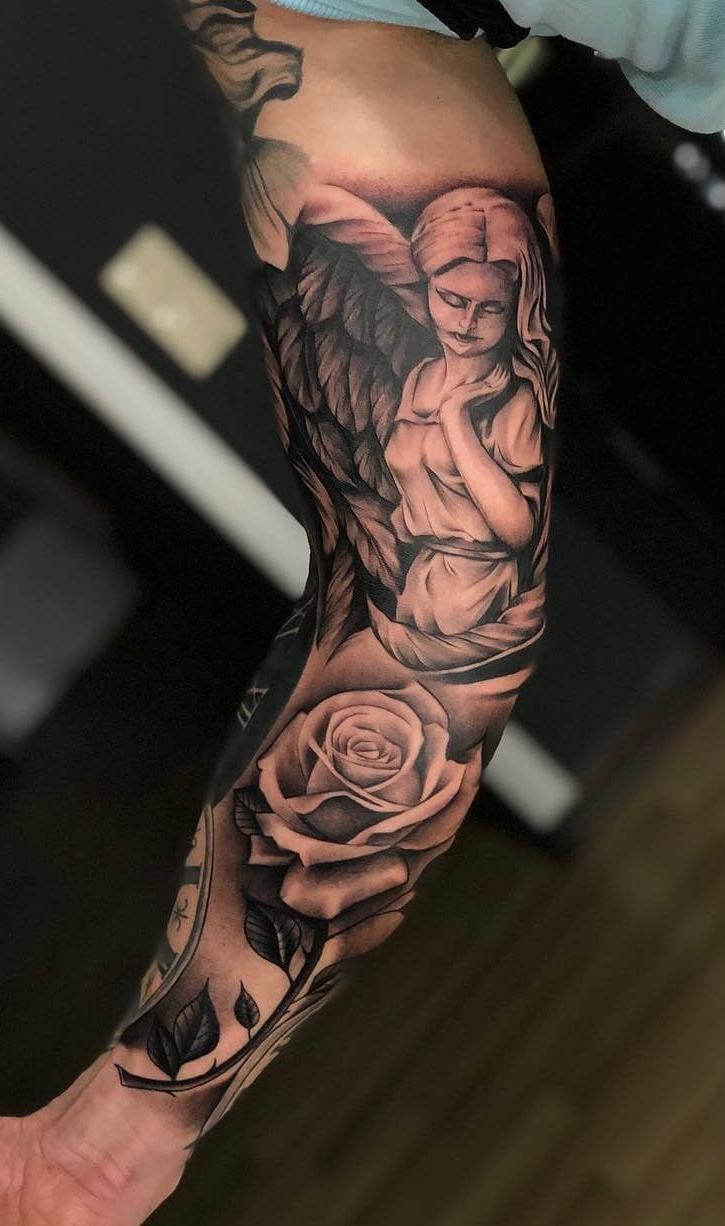 tatuagem-de-braço-fechado-religiosa