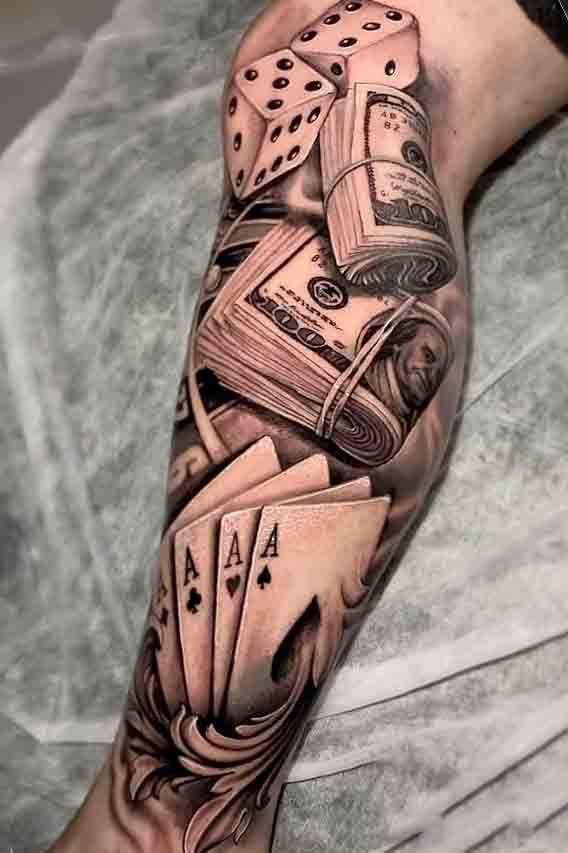 tatuagem-de-dados-dinheiro-e-baralho-na-perna