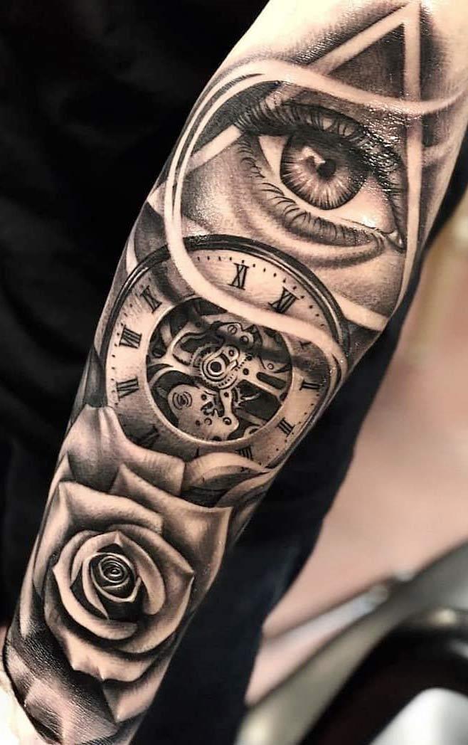 tatuagem-no-antebraço-de-olho-relogio-e-rosa