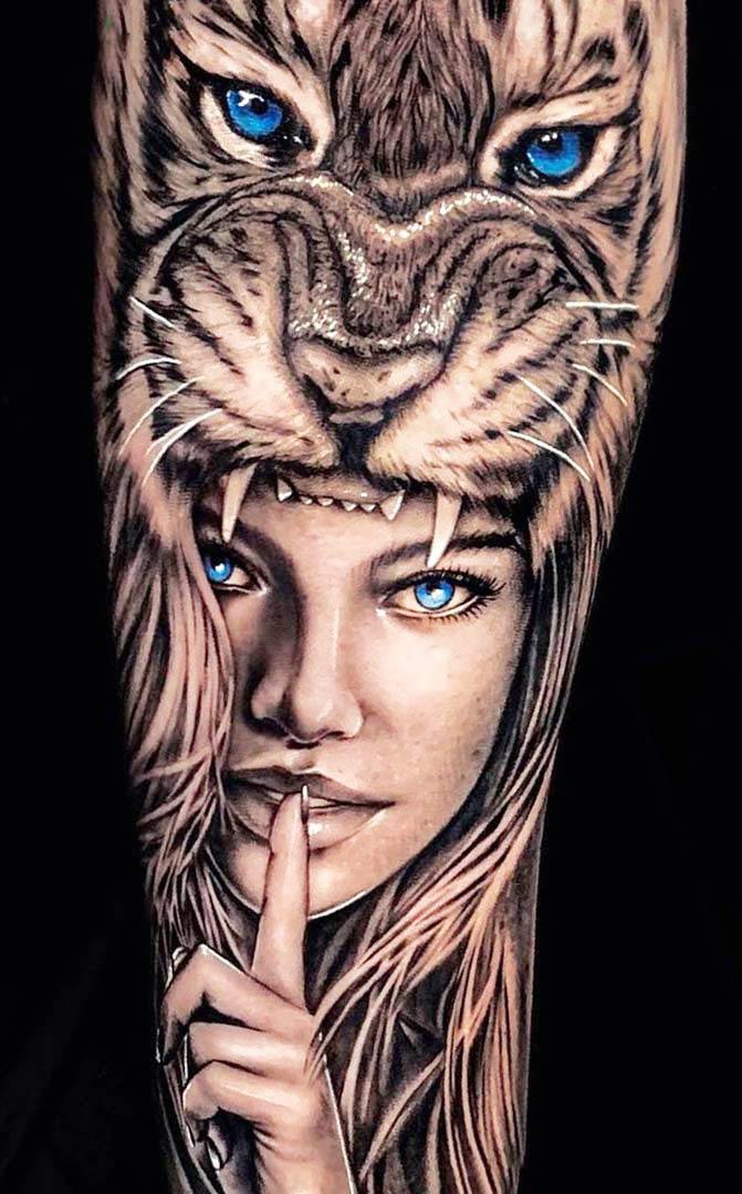 tatuagem-de-mulher-na-boca-de-um-tigre