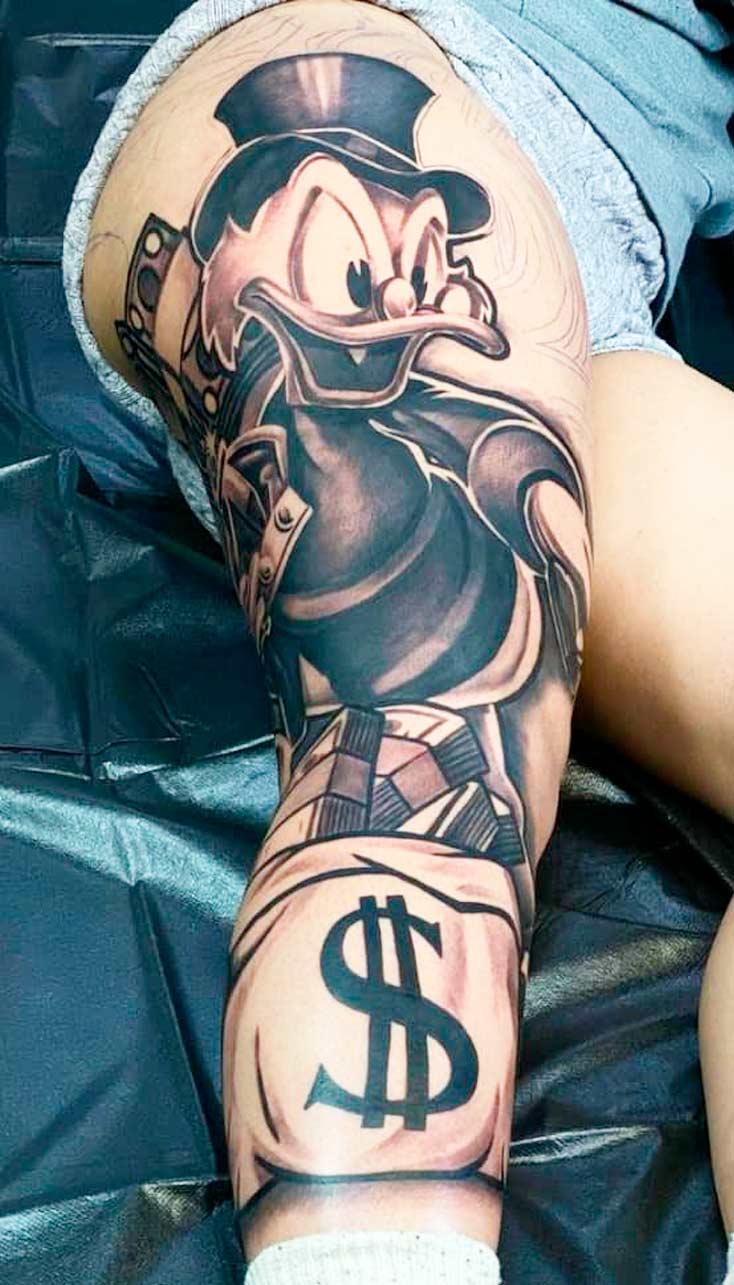 tatuagem-do-tio-patinhas-na-perna