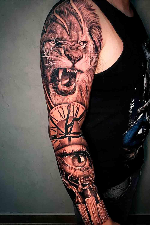 braco-fechado-de-tatuagens-de-leao-relogio-e-olho